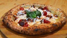 Qualità dei cibi in ottica di buon vivere, concetto di Pizza Wip Burger